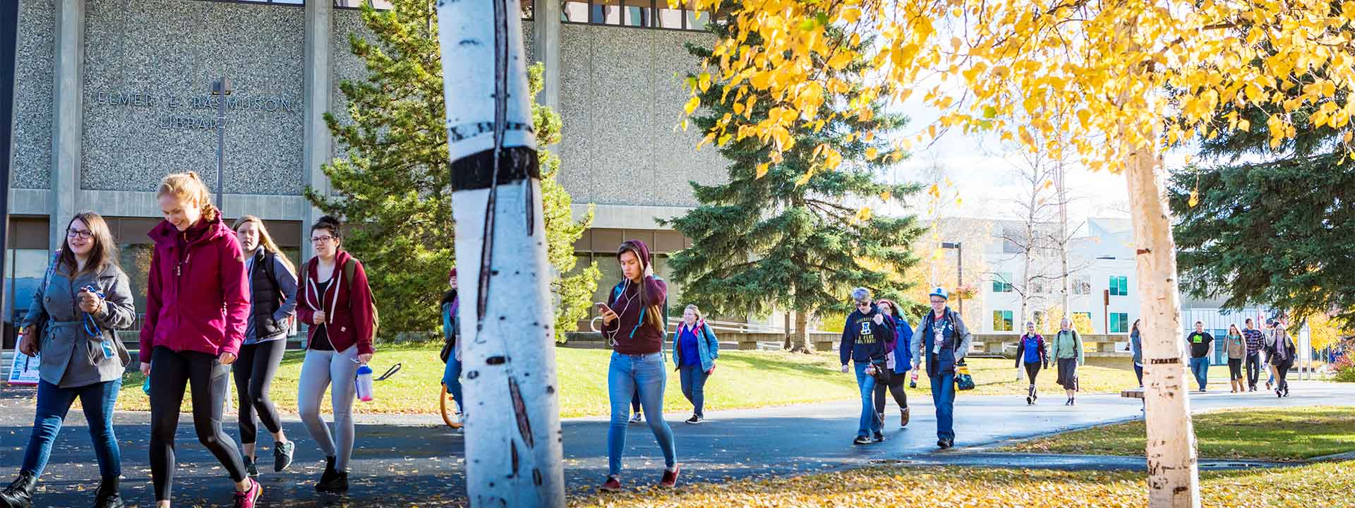 UAF students walk across Constitution Plaza on a fall day on the Fairbanks campus.