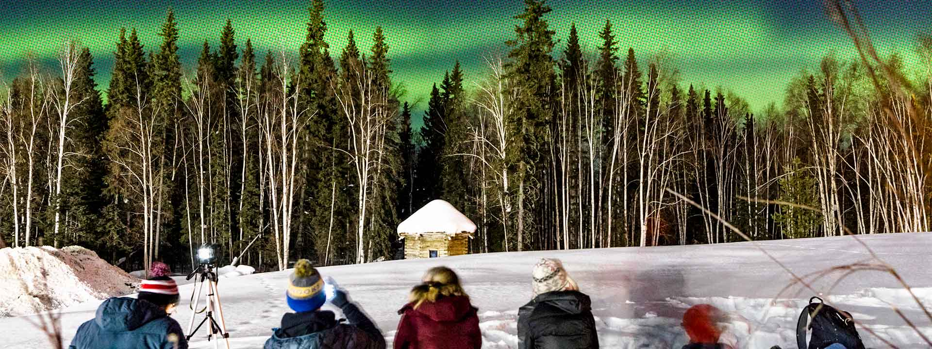 Students viewing the Aurora on a winter night outside the UA Museum of the North