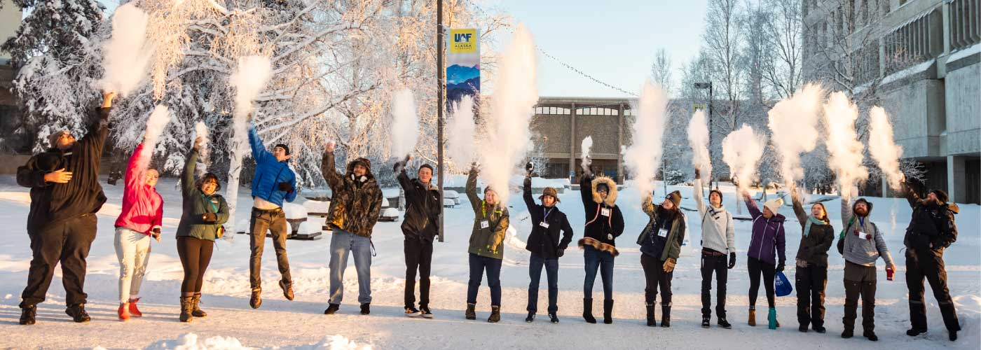 Students on the UAF campus toss water into the air as it instantly freezes at -40 degrees.