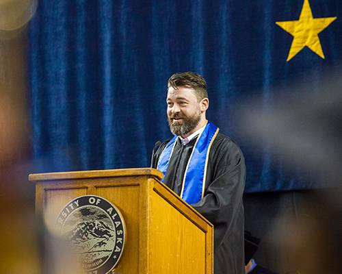 Academy Award winner and former UAF alum Ben Grossmann speaks to graduates during the 2015 commencement ceremony at the Carlson Center.
