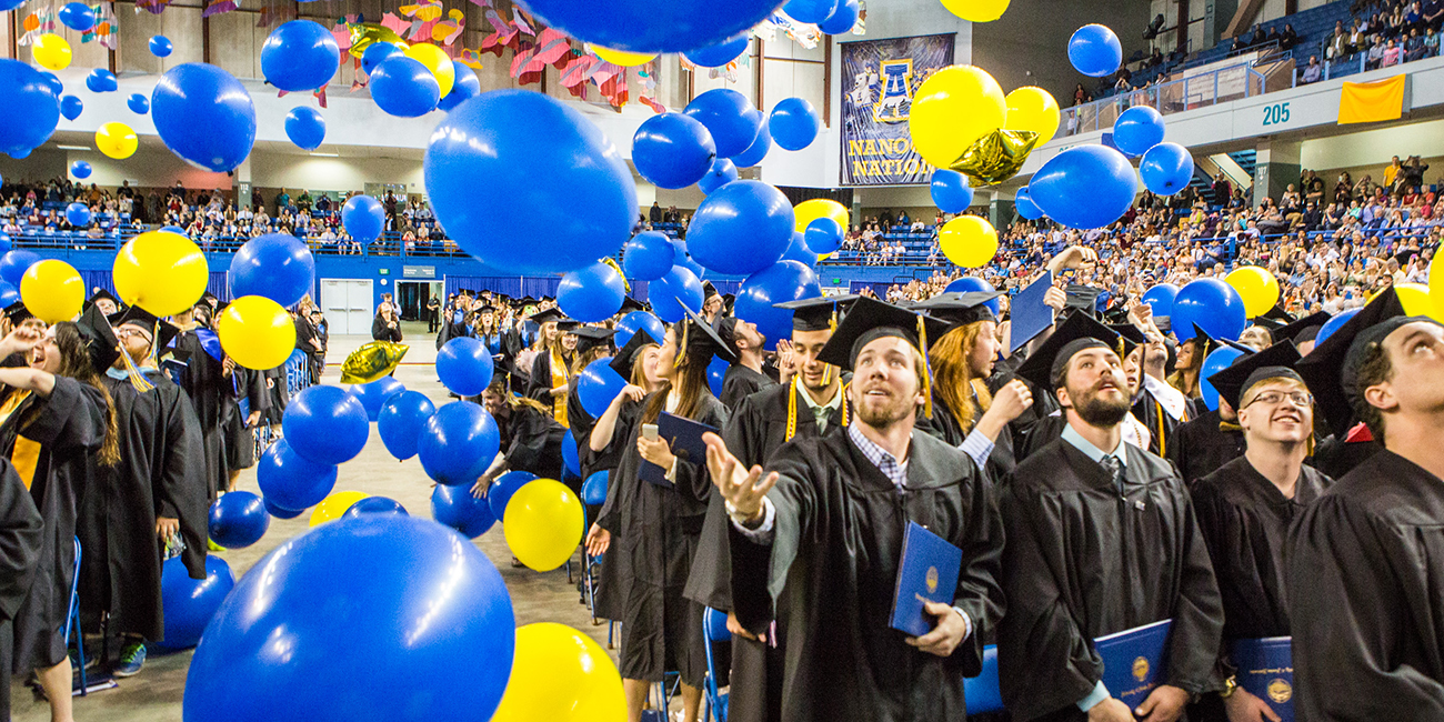 Graduates react to the ceremonial balloon drop during the Commencement 2016 ceremony.