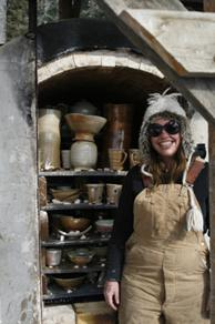 Smiley Heidi with salt kiln filled with work