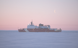 Icebreaker ship in frozen Arctic waters