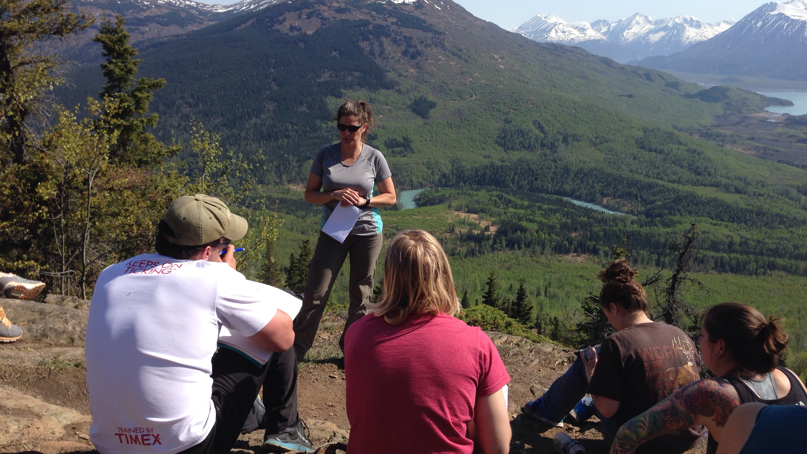 Ecologist Elizabeth Bella discusses how recent wildfires had changed the landscape with UAF students on a natural resources field tour. They were hiking in the Skilak Wildlife Recreation Area.