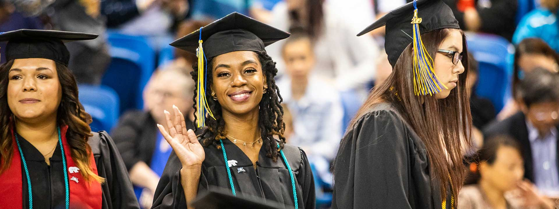 Graduates take wave to the crowd at the 2019 commencement ceremony at the Carlson Center