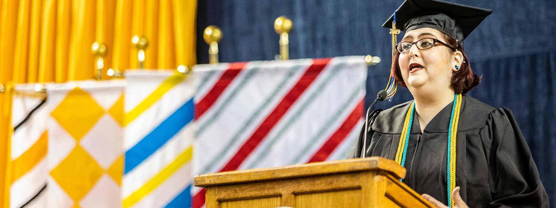 The 2019 student speaker gives their commencement address at the Carson Center