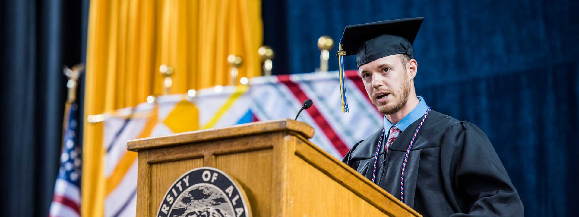 The 2018 student speaker gives their commencement address at the Carson Center
