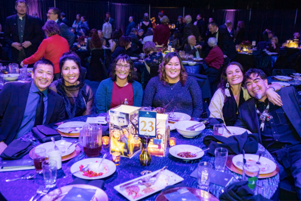 2019 Blue and Gold Celebration attendees smile around their table
