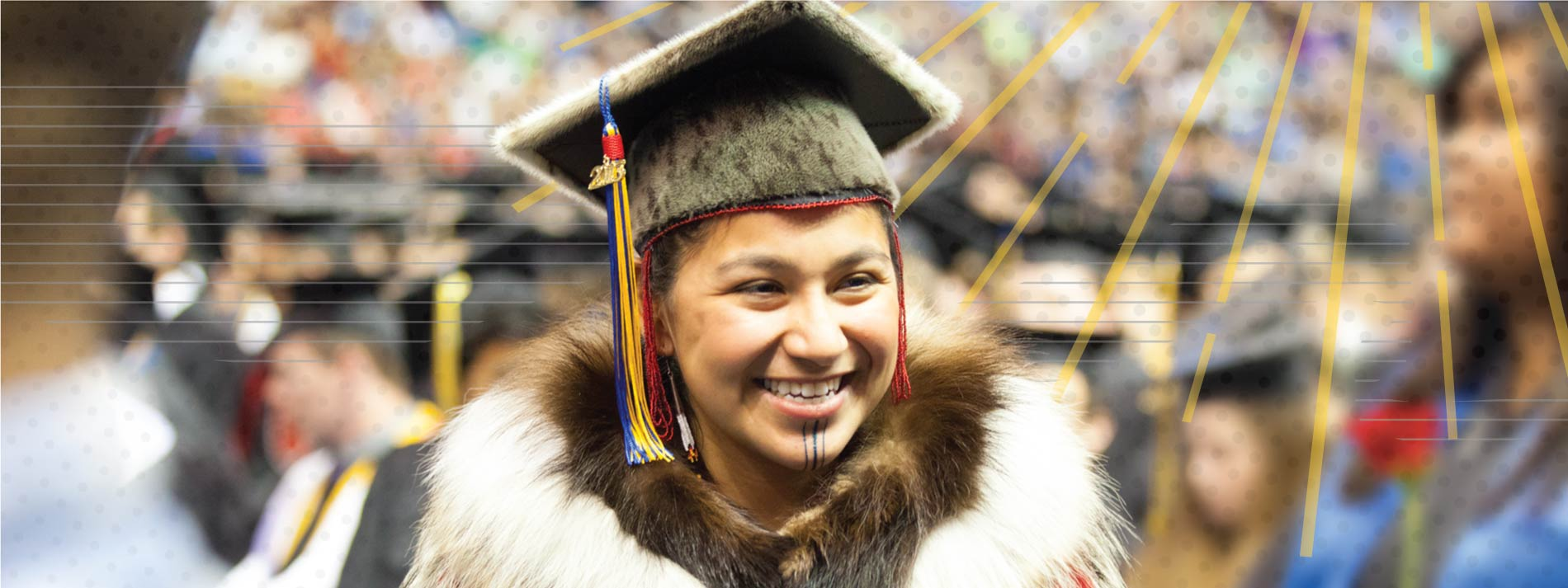 Alaska Native woman in regalia at UAF commencement