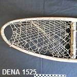 Close-up of front part of snowshoe, showing the sinew webbing. The background is black.