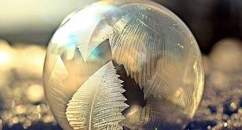 Frozen soap bubble on snow.