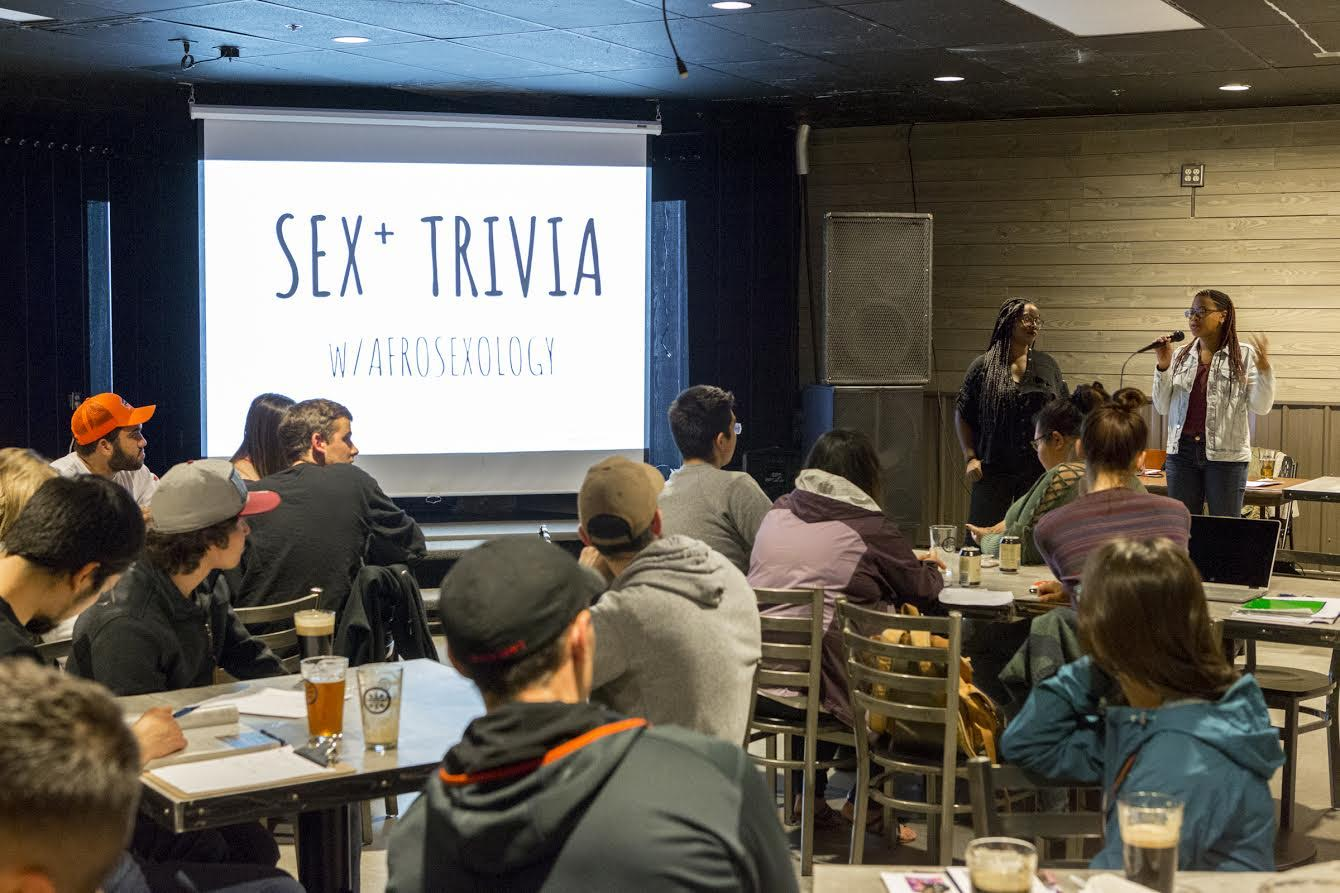"Sex+ Trivia at The Pub hosted by special guests ""Afrosexology"" in September 2018. Photo by UAF photographer Sarah Manriquez."