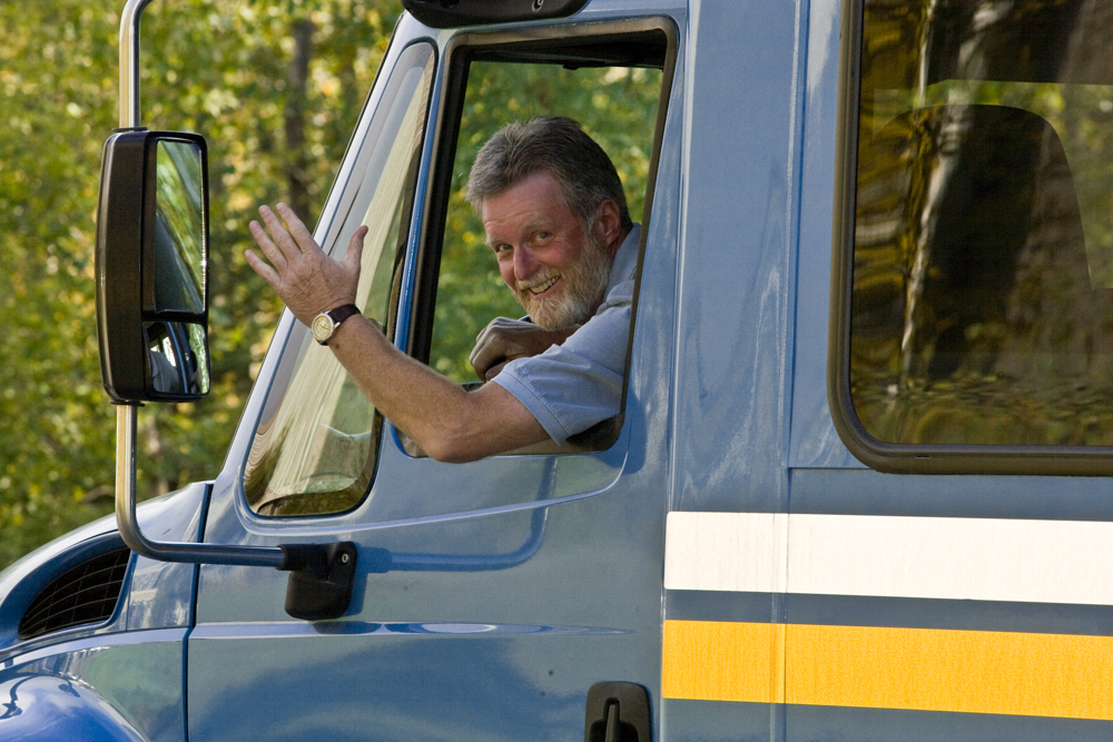 A shuttle bus driver waves as he makes his way around the Fairbanks campus. UAF photo by Todd Paris.