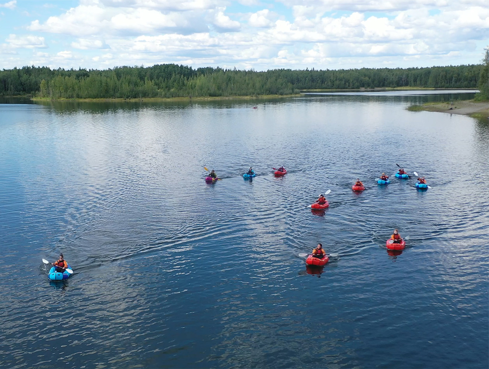 Girls in the Forest participants and instructors practice their packrafting skills in the Chena Lake Recreation Area.