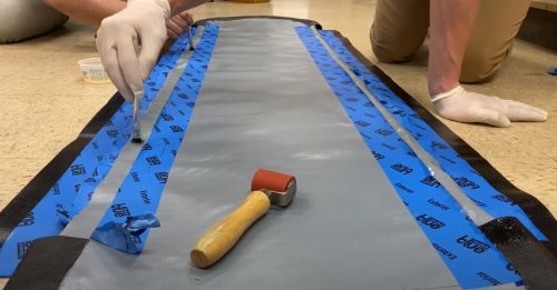 A team of UAF mechanical engineering students used their senior project to design a better and more mobile inflatable emergency backboard. Photo courtesy of Amanda Byrd.