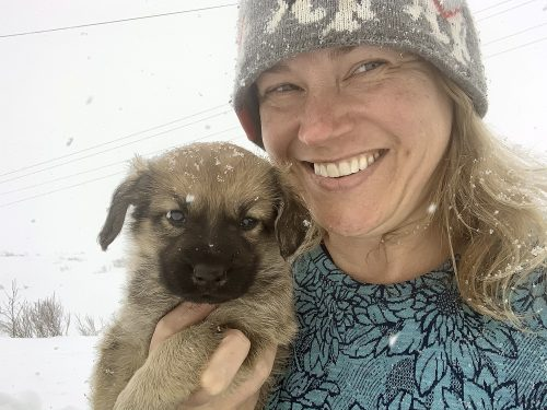 Veterinarian Laurie Meythaler-Mullins holds a puppy in the village of Nightmute, Alaska. Photo courtesy Laurie Meythaler-Mullins