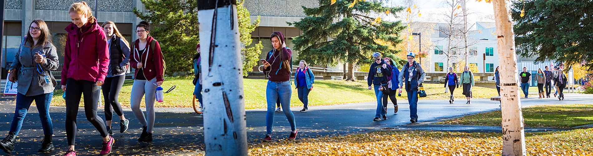 Students walking across the UAF campus.