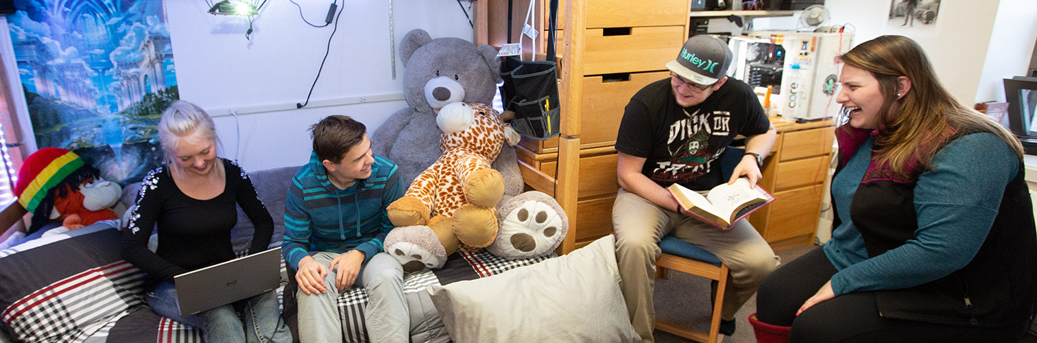 Students in a MBS dorm room