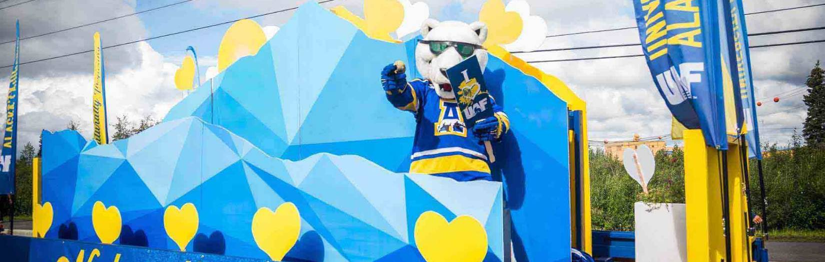 The Nanook Mascot waves from the UAF float at the annual Fairbanks Golden Days parade.