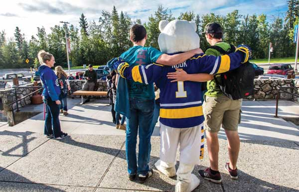 Students at MBS complex pose with the Nanook mascot