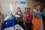 ACEP Director Gwen Holdmann, left, demonstrates wind energy potential with a couple Fairbanks-area school kids before her address at the Science for Alaska Lecture Series in the Westmark Hotel.