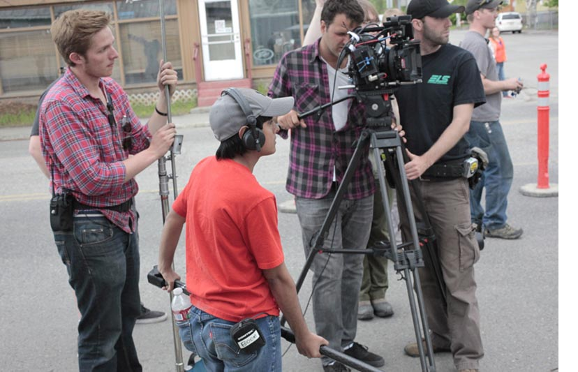 "Students work with  industry professionals onset in Downtown Fairbanks on the set of ""Feels Good"" during the 2014 Film Reel Alaska Mentor Experience program."