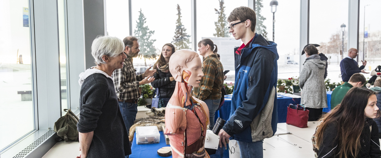 Prospective students mingle with UAF faculty members in the Murie Building during campus preview day