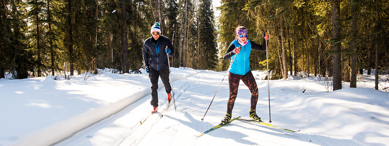 UAF students skiing on campus trails
