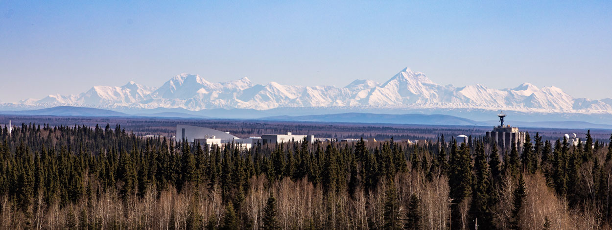 The Alaska Range is seen to the south of the UAF campus on a clear spring day