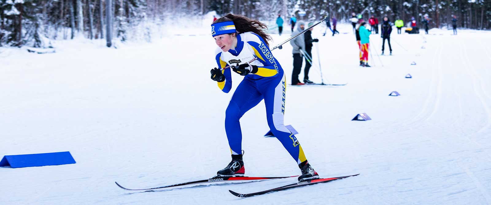 An Alaska Nanooks cross country skier on the Fairbanks campus trails