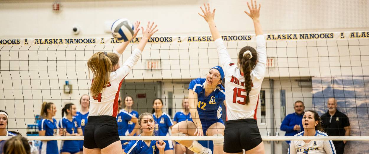 Alaska Nanooks volleyball players competing in a game.
