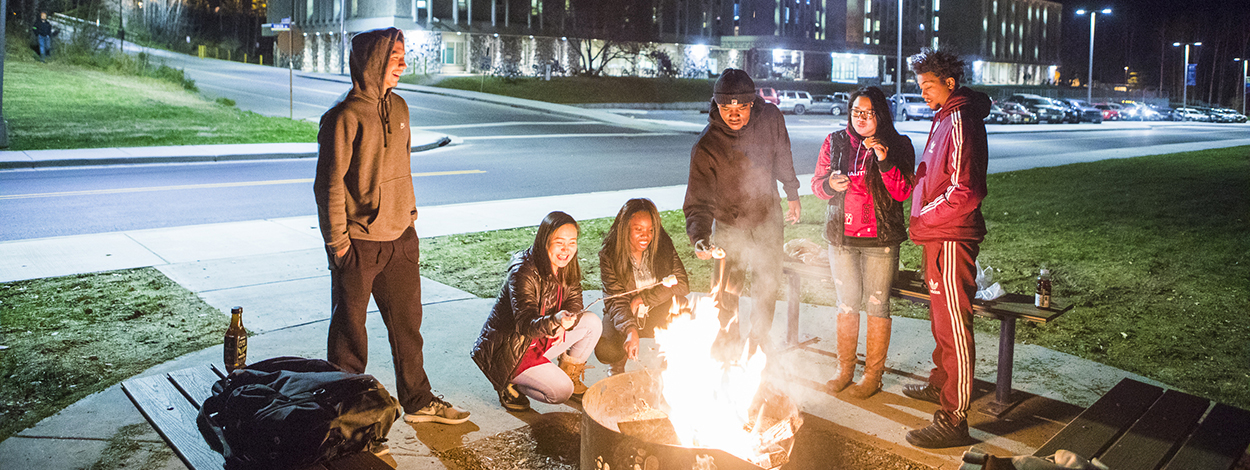 UAF tudents attend a bonfire near the MBS residence hall complex