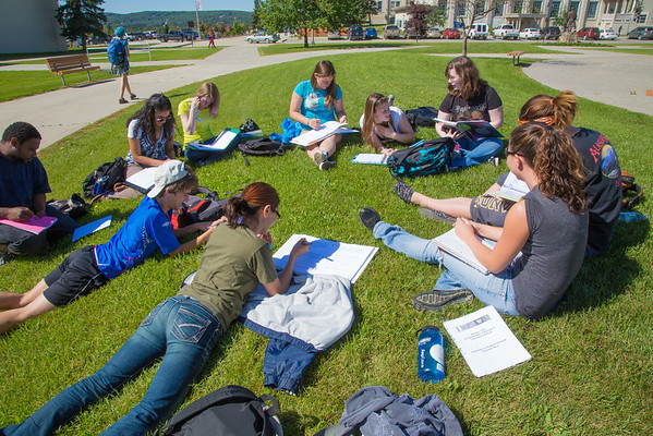 A group of UAF students study outside in the plaza outsize Signers Hall