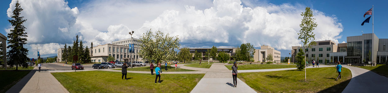 Panorama photo of Cornerstone Plaza during a cloudy summer day at UAF